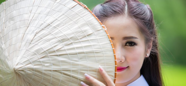 Amadea -Frauen in traditioneller Tracht, Vietnam